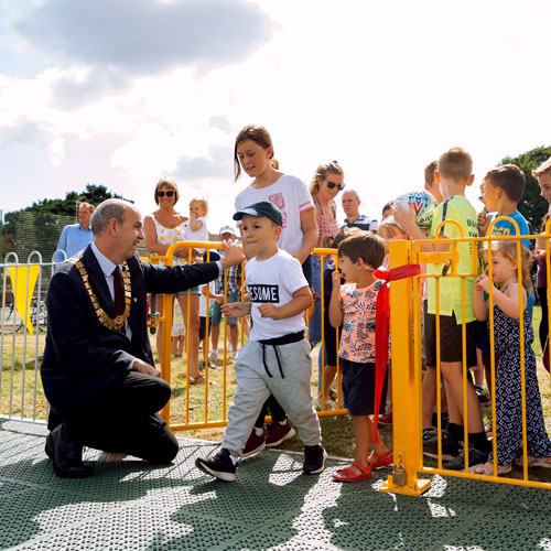 Children entering their new playground during opening event